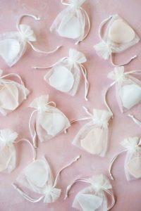 Amarie's bath flowers - petals and gift bags on pink background